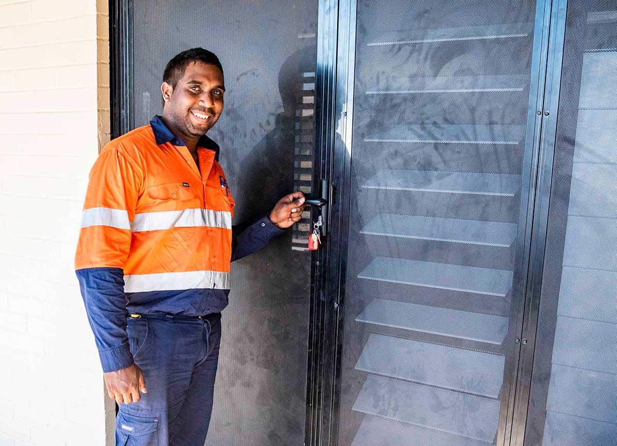 Desmond Minyingma outside upgraded house