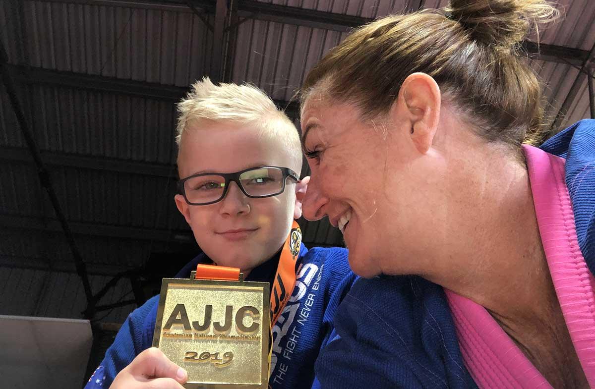Queenie Warhurst and Jax Gardiner with his award