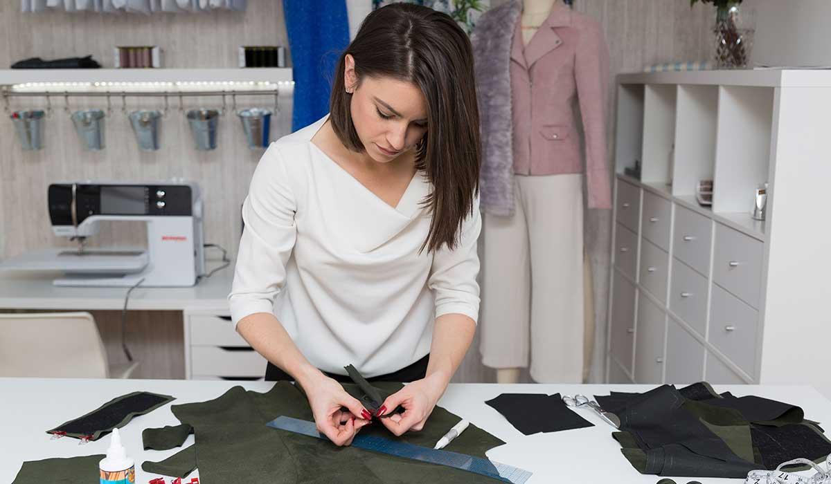 Aneka sewing a garment
