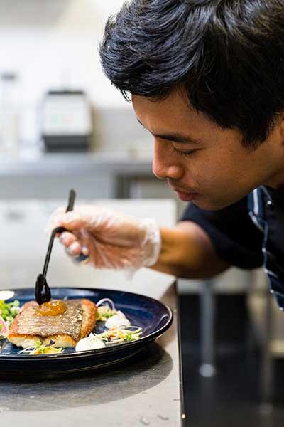 Student preparing plate of food