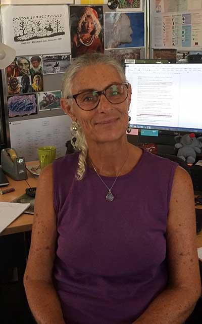 Meg McGrath a Workforce Training Coordinator sitting at her desk