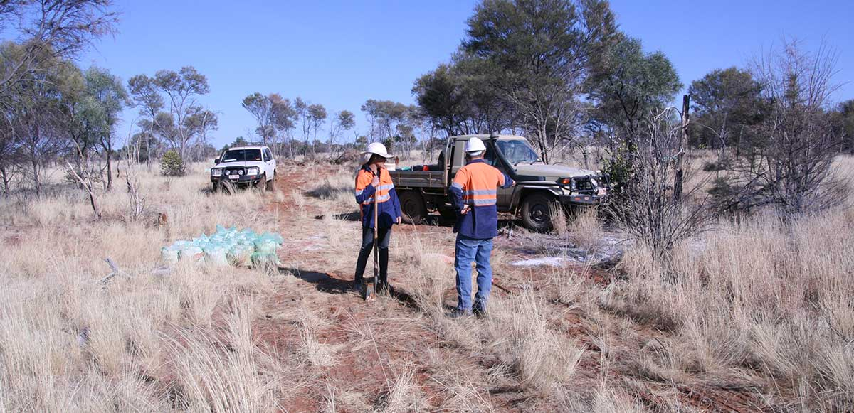 Workmen and trucks in remote Northern Territory
