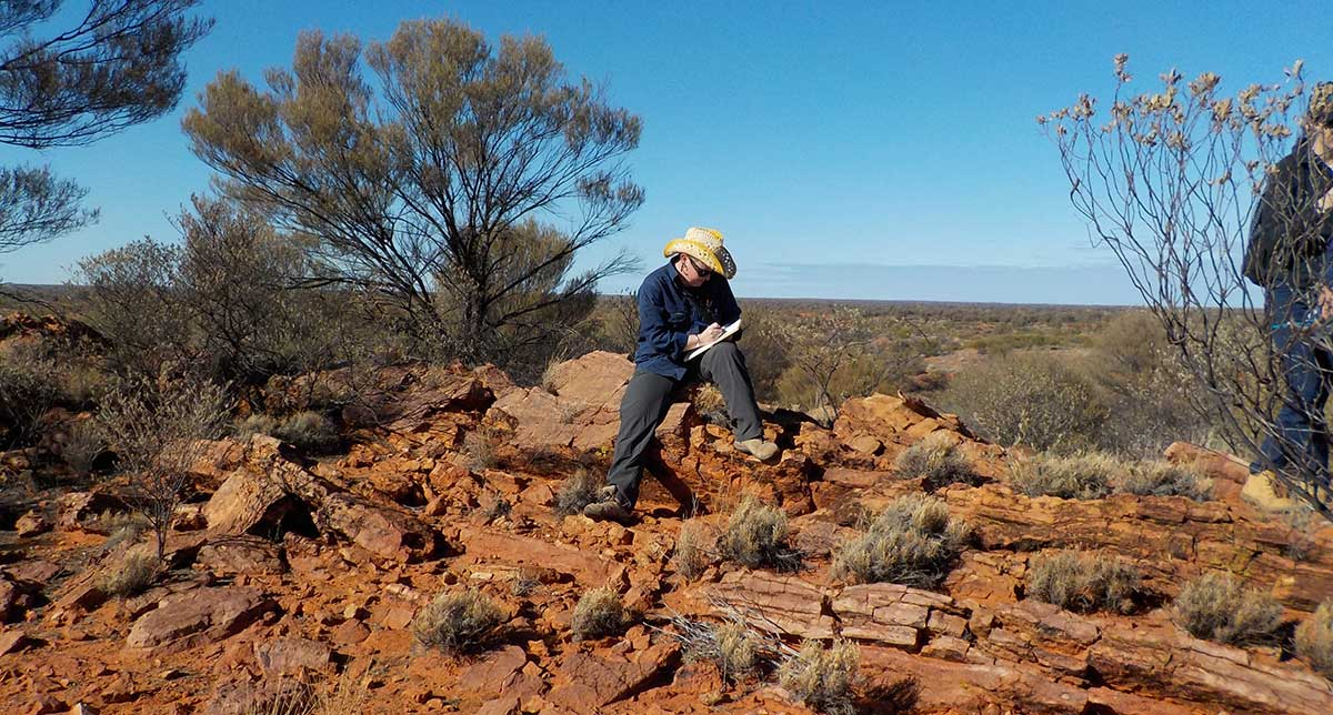 Man sitting on rocks in remote Northern Territory