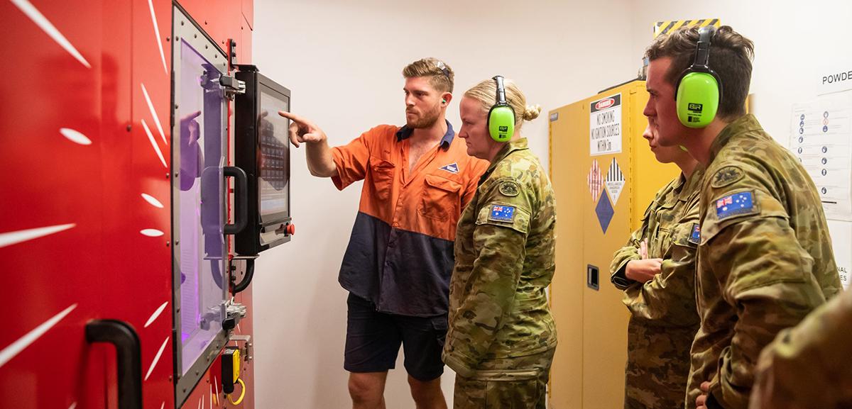 Australian Army staff viewing the Spee3D printer