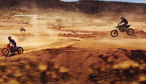 Dirt bikes riding on sand dunes