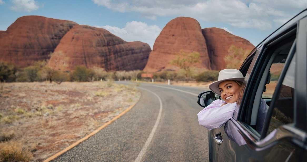 Car driving towards Uluru
