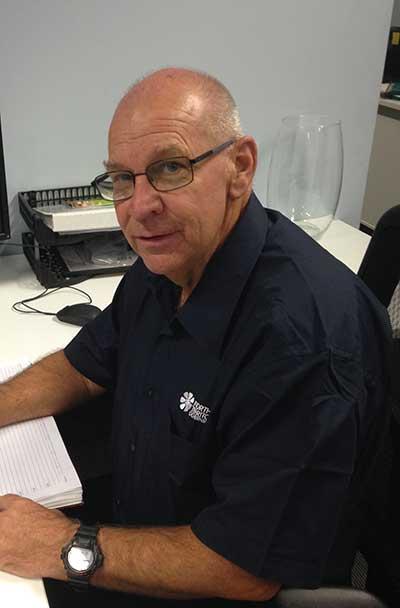 Grant Butler sitting at his desk