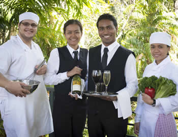 Two young women and two young men learing about hospitality in the 2010s
