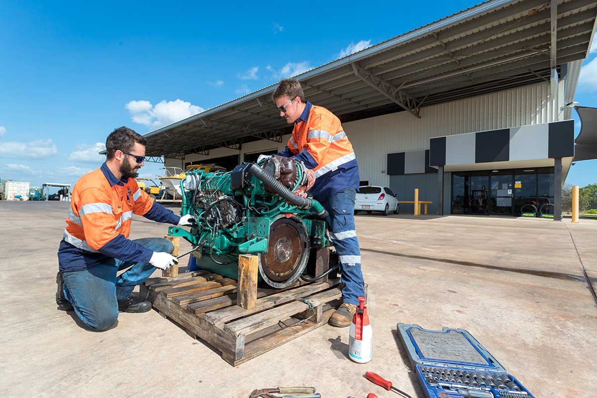 Two men working on an engine