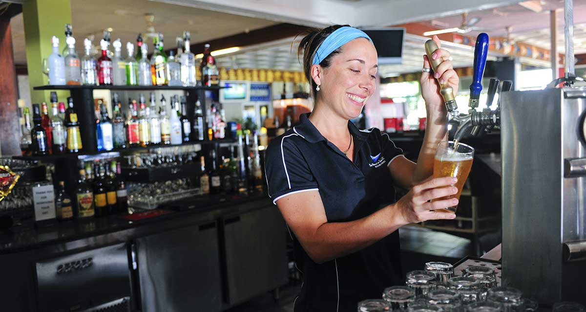 Bar person pouring beer