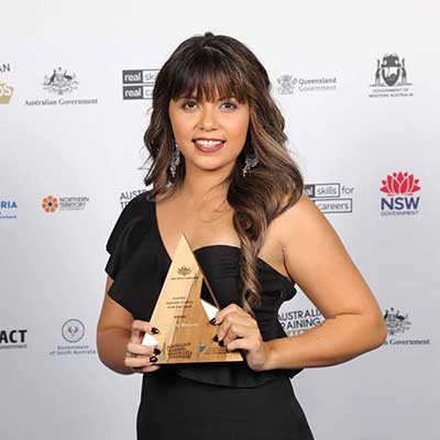 Kimberley Brewster with her Australian Trainee of the Year award from the Australian Training Awards