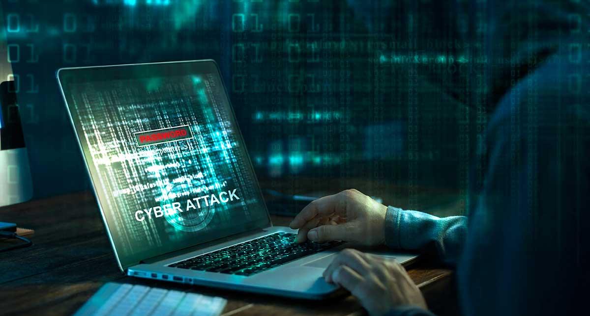 Hacker working on a laptop