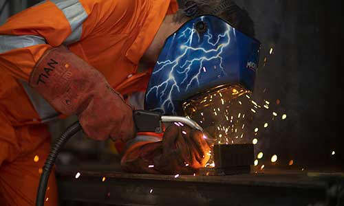 Workman welding steel