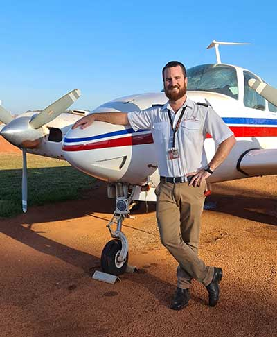 Mick Ellern of Air Arnhem standing next to a plane