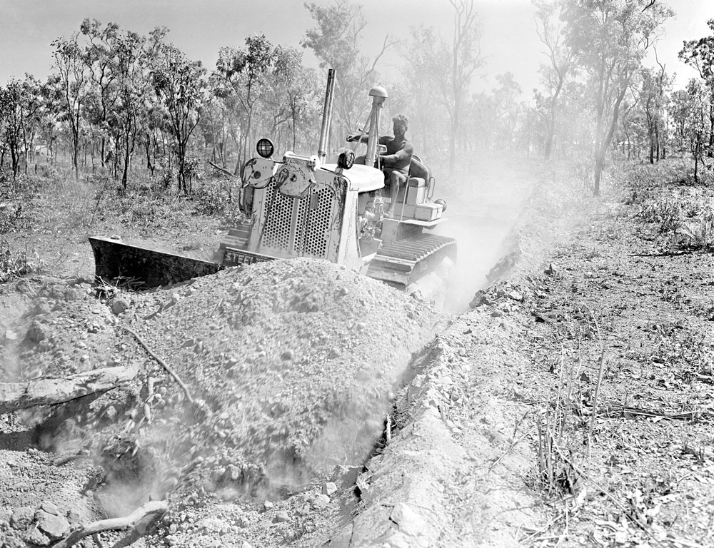 Bulldozer costeaning at Rum Jungle mine site (1955). National Archives of Australia: A1200, L19450