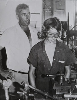 Teacher supervising student in workshop during the 1970s