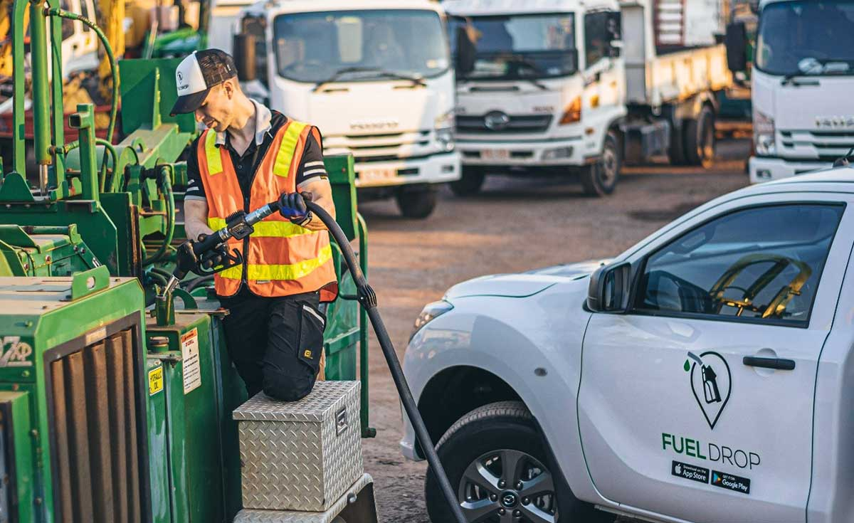 Fuel Drop employee refilling a fuel tank