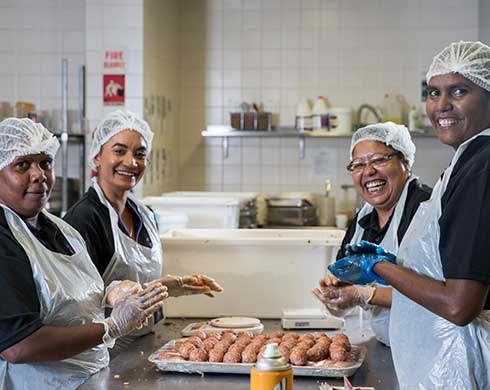 Aboriginal women working in a kitchen