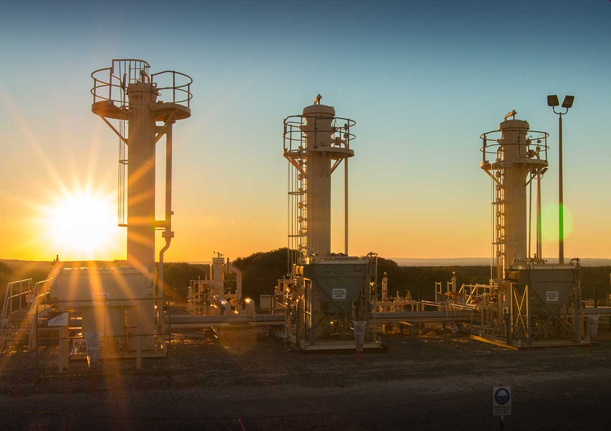 Land based gas facility at sunset