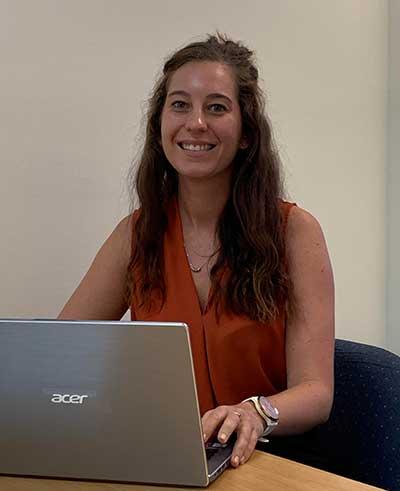 Rhiannon Plume working on a laptop