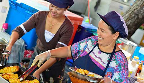Women working on a food stall