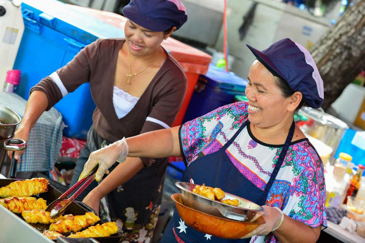 Two women working in a food staff