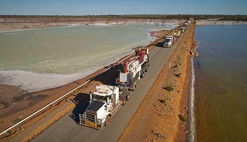 Road training transporting mining equipment