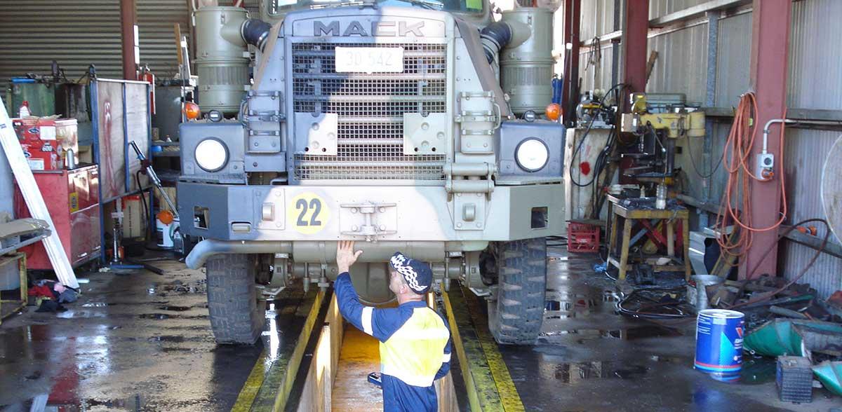 Mechanic fixing an army truck