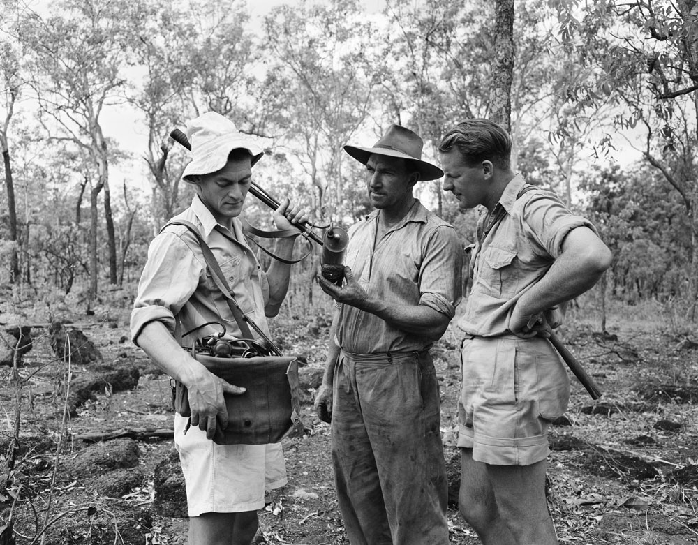 Geophysicist Don Dyson (left), Jack White (middle) and Geologist Hector Ward examining ore sample at Rum Jungle using Geiger counter (1955). National Archives of Australia: A1200, L19445