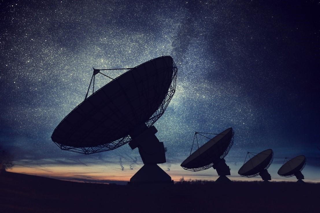 Satellite dishes at night