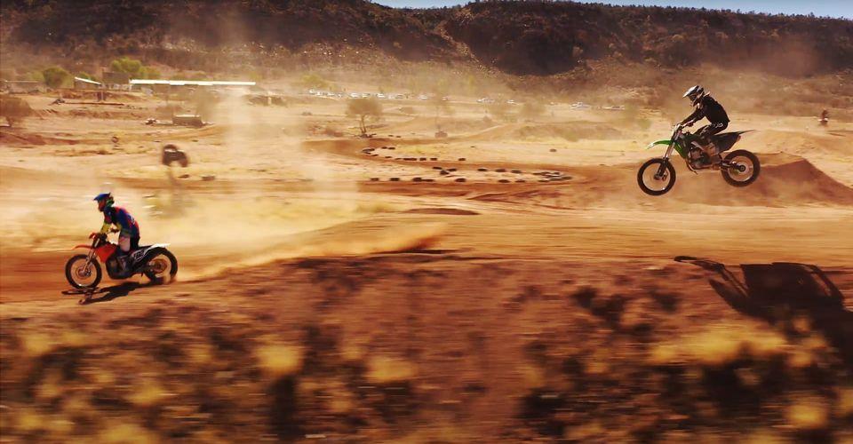 Motocross bikes being ridden through the desert