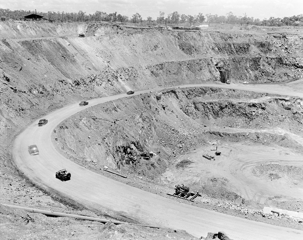 Vehicles driving into White's open cut pit, Rum Jungle (1958). National Archives of Australia: A1200, L26915
