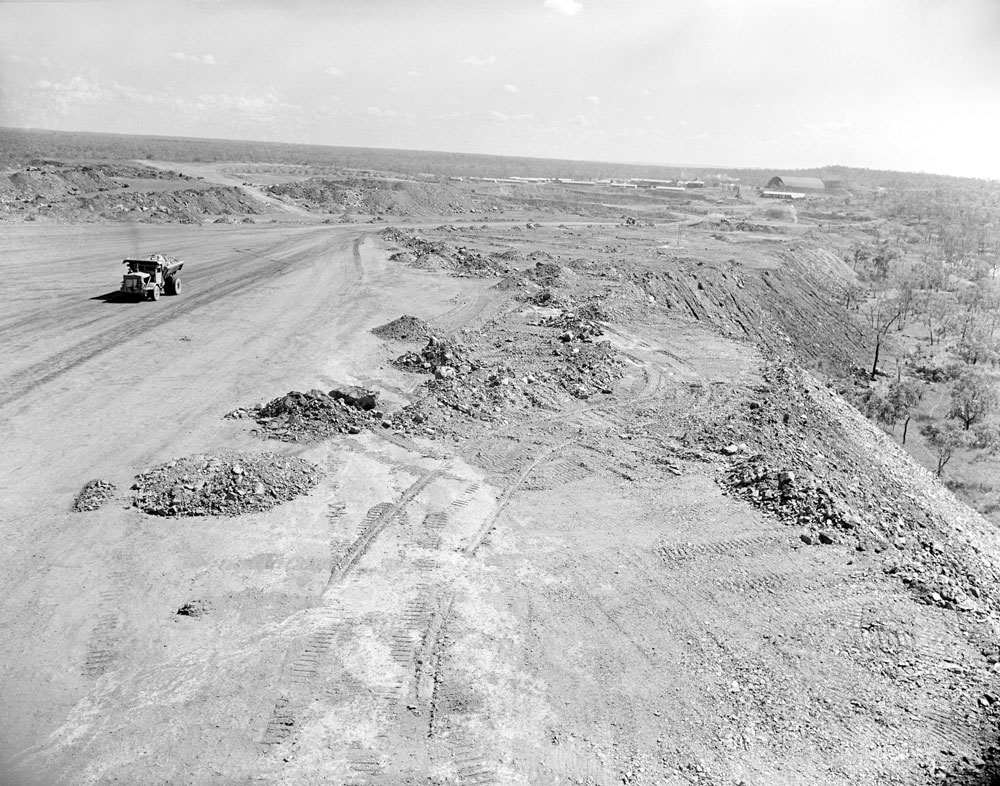 Top of White's overburden heap with treatment plant and stockpile areas in the background, Rum Jungle (1957). National Archives of Australia: A1200, L23109