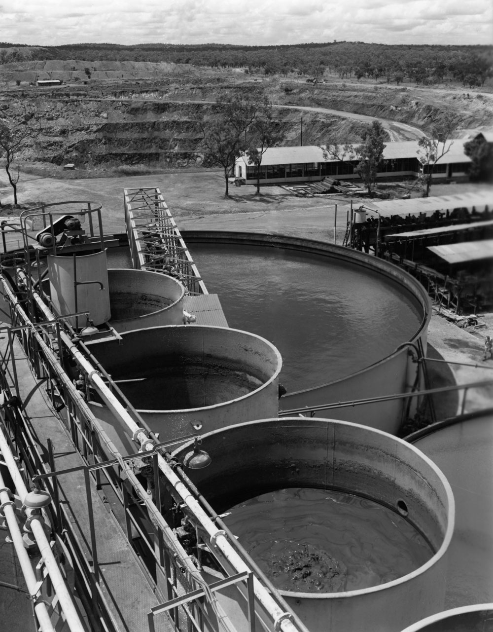 Treatment plant area in foreground with White's open cut pit in the background (1958). National Archives of Australia: A1200, L25505